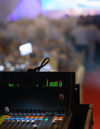 Sound Control by professional producer,sound mixer and recording audio in stage in concert or event light night party background.
